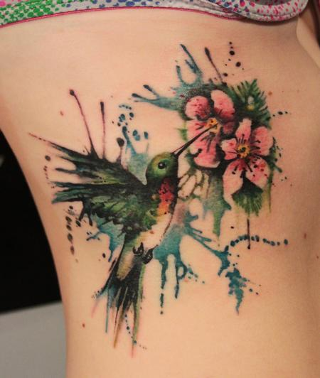 Humming Bird Tattoo With Flowers