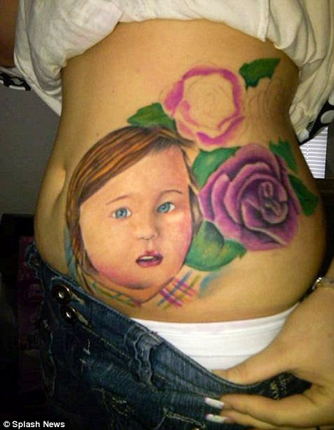 Kid Face & Flowers Tattoo On Side Belly