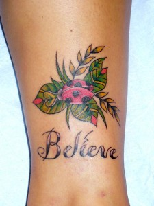 Lady Bug On Leaves With Believe Tattoo