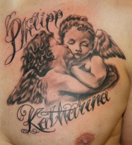 Baby Angel Kissing Tattoo On Chest