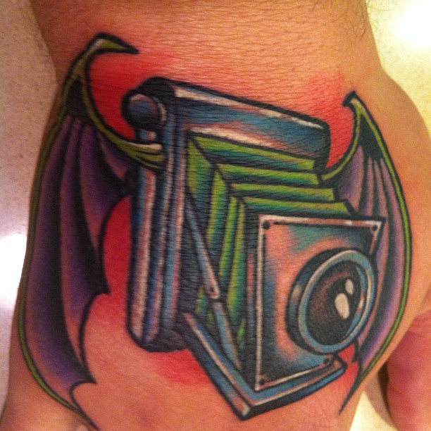 Bat Winged Camera Tattoo
