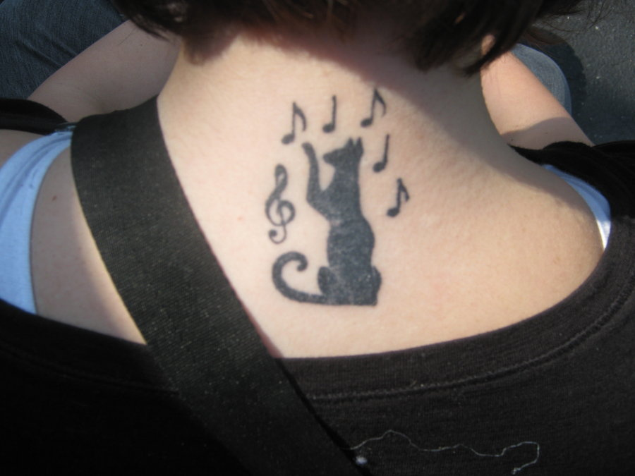 Black Cat & Music Notes Tattoo On Upper Back
