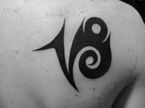 Black Ink Capricorn Sign Tattoo On Back Shoulder