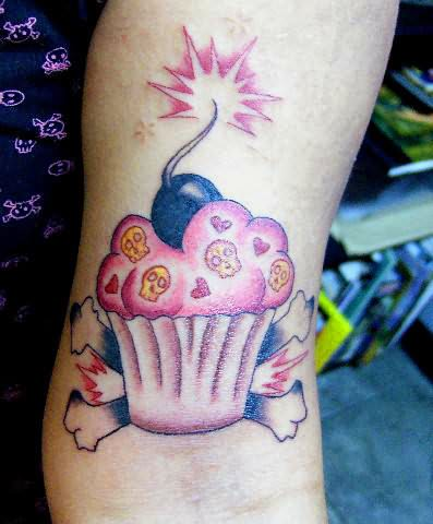 Cake Bomb Tattoo On Muscles