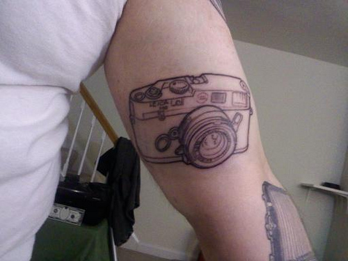 Camera Outline Tattoo On Biceps