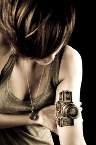 Camera Tattoo On Biceps For Girls