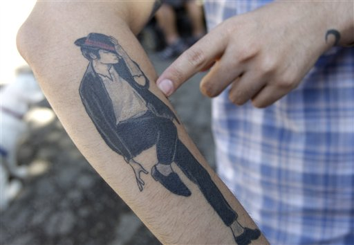 Celebrity MJ Tattoo On Forearm