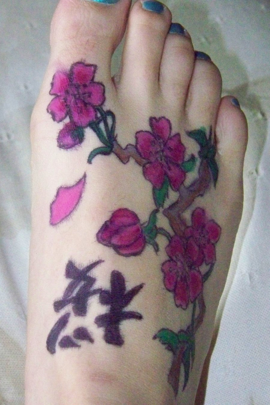 Cherry Blossom Tattoo With Chinese Letters On Foot