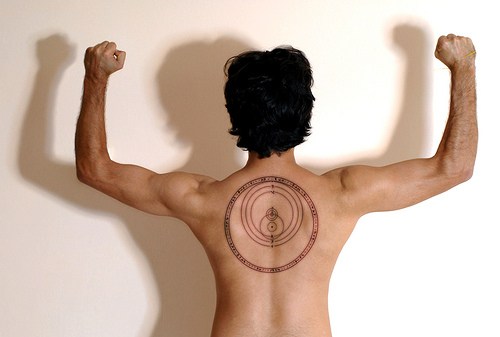 Circles Tattoo On Back For Guys