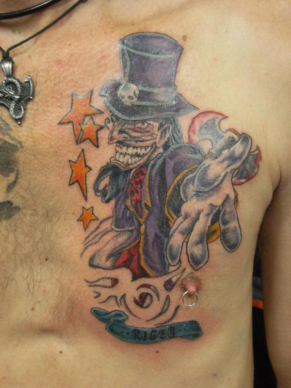 Clown With Hat Tattoo On Chest