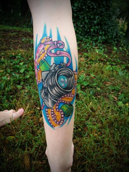 Color Ink Camera Tattoo On Back Leg