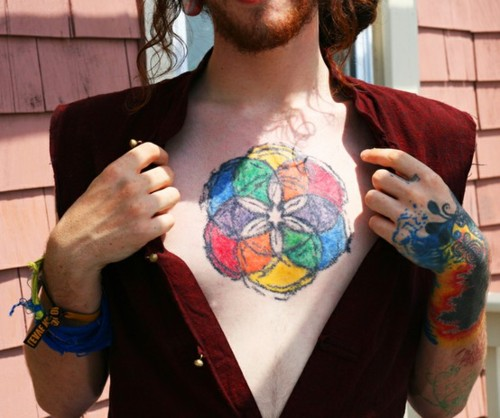 Colorful Circles Tattoo On Chest