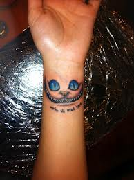 Cute Cat Face Tattoo On Wrist