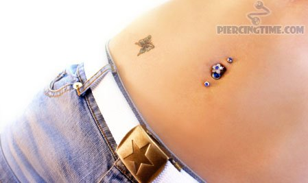 Double Belly Button Piercing & Butterfly Tattoo