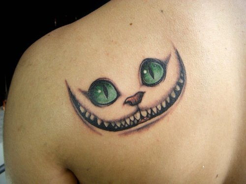 Green Eyed Cat Face Tattoo Design