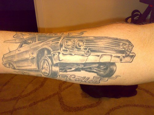 Grey Ink Car Tattoo Design