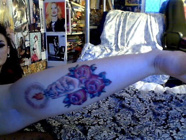 Hand Held Candle Tattoo With Roses