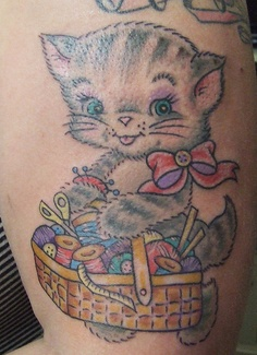 Lovely Cat Holding Basket Tattoo