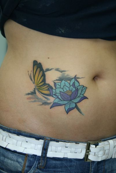 Lovely Flower With Butterfly Tattoo On Belly