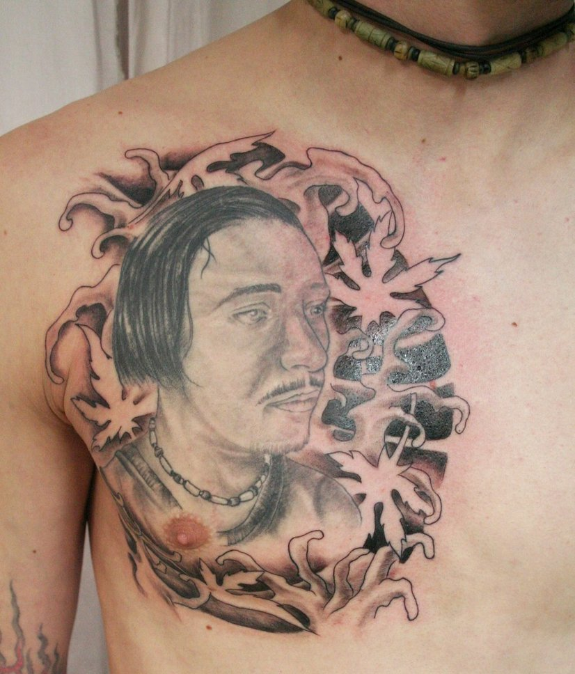 Man Face Tattoo On Chest