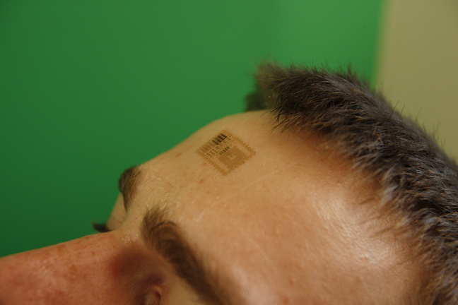 Micro Chip Tattoo On Forehead
