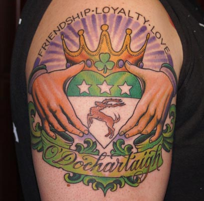 Outstanding Claddagh Tattoo On Biceps