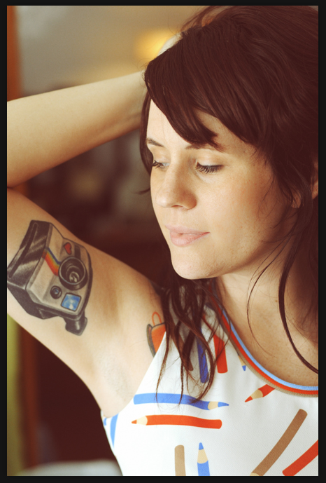 Polaroid Camera Tattoo On Biceps For Girls