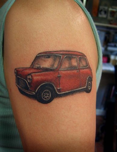 Red Mini Car Tattoo On Biceps