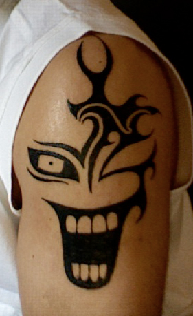 Simple Clown Face Tattoo On Shoulder