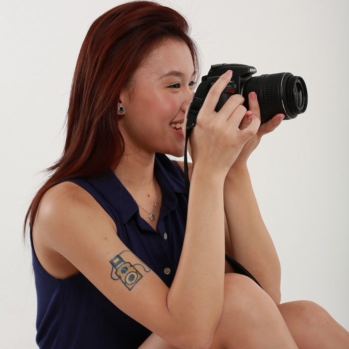 Small Camera Tattoo On Biceps For Girls