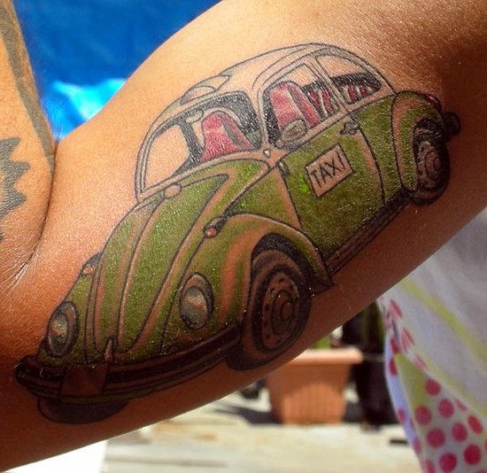 Taxi Car Tattoo On Muscles