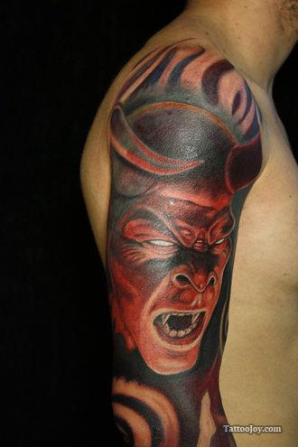 Angry Devil Tattoo Design On Arm
