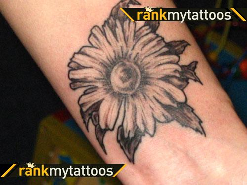 Awesome Daisy Flower Tattoo