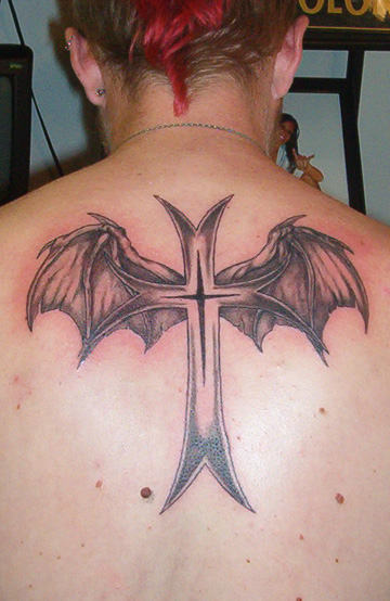 Bat Winged Cross Tattoo On Upper Back