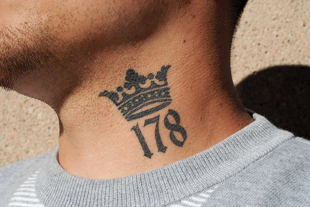 Black Ink Crown Tattoo Design For Neck