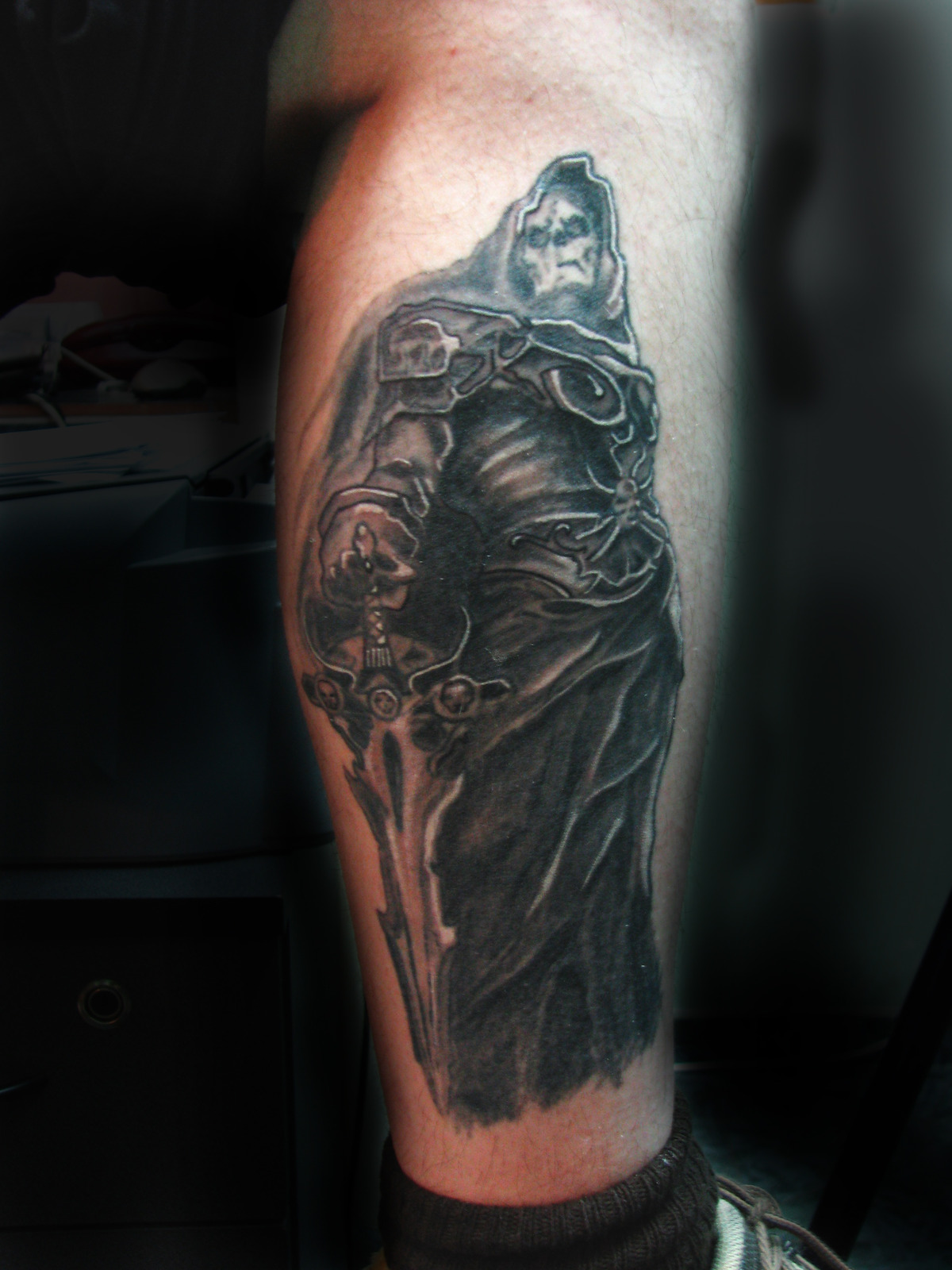 Black Ink Death Tattoo On Leg