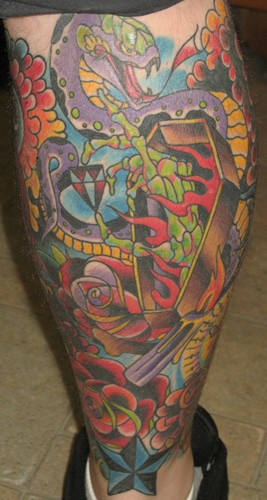 Colorful Coffin Tattoo On Back Leg