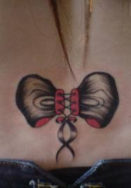 Corset Bow Tattoo On Lower Back