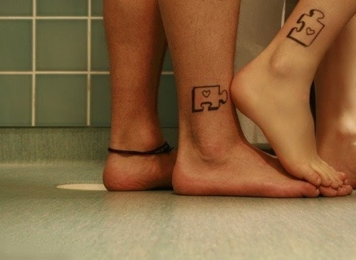 Couple Having Puzzle Tattoo Design On Akles