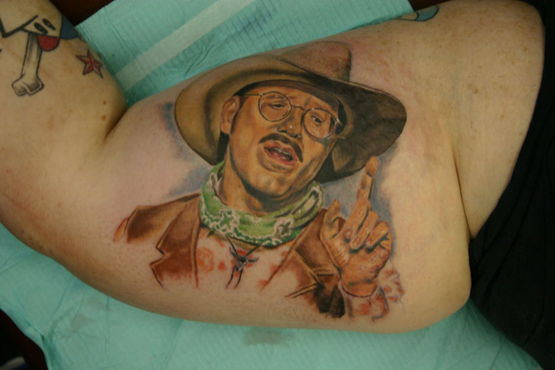 Cowboy Portrait Tattoo On Muscles