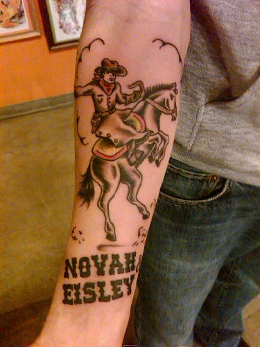 Cowboy Riding Horse With Name Tattoo On Forearm