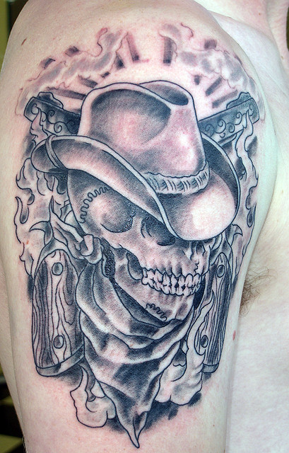 Cowboy Skull With Crossing Revolvers Tattoo On Upper Arm