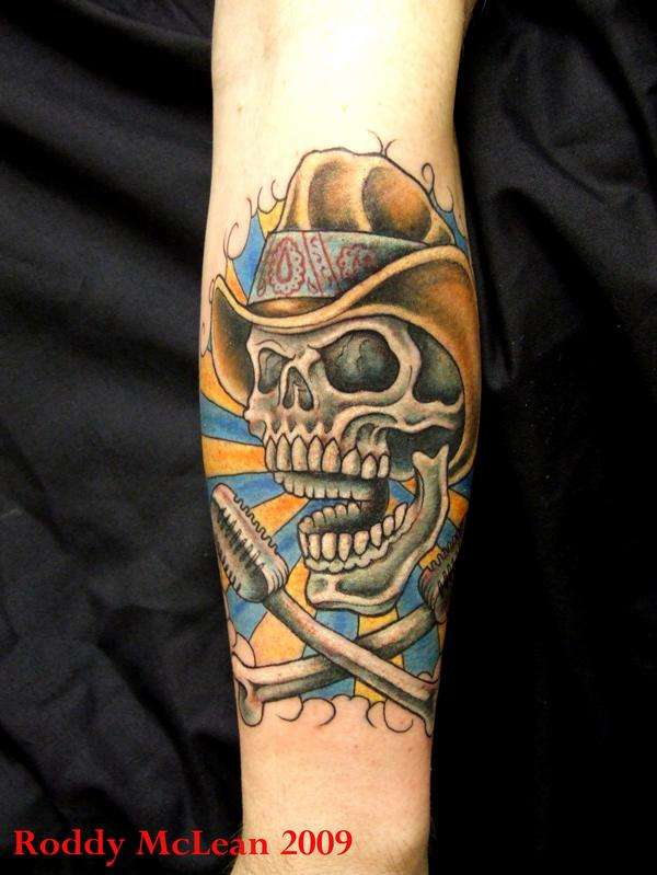 Crawling Cowboy Skull Tattoo Design