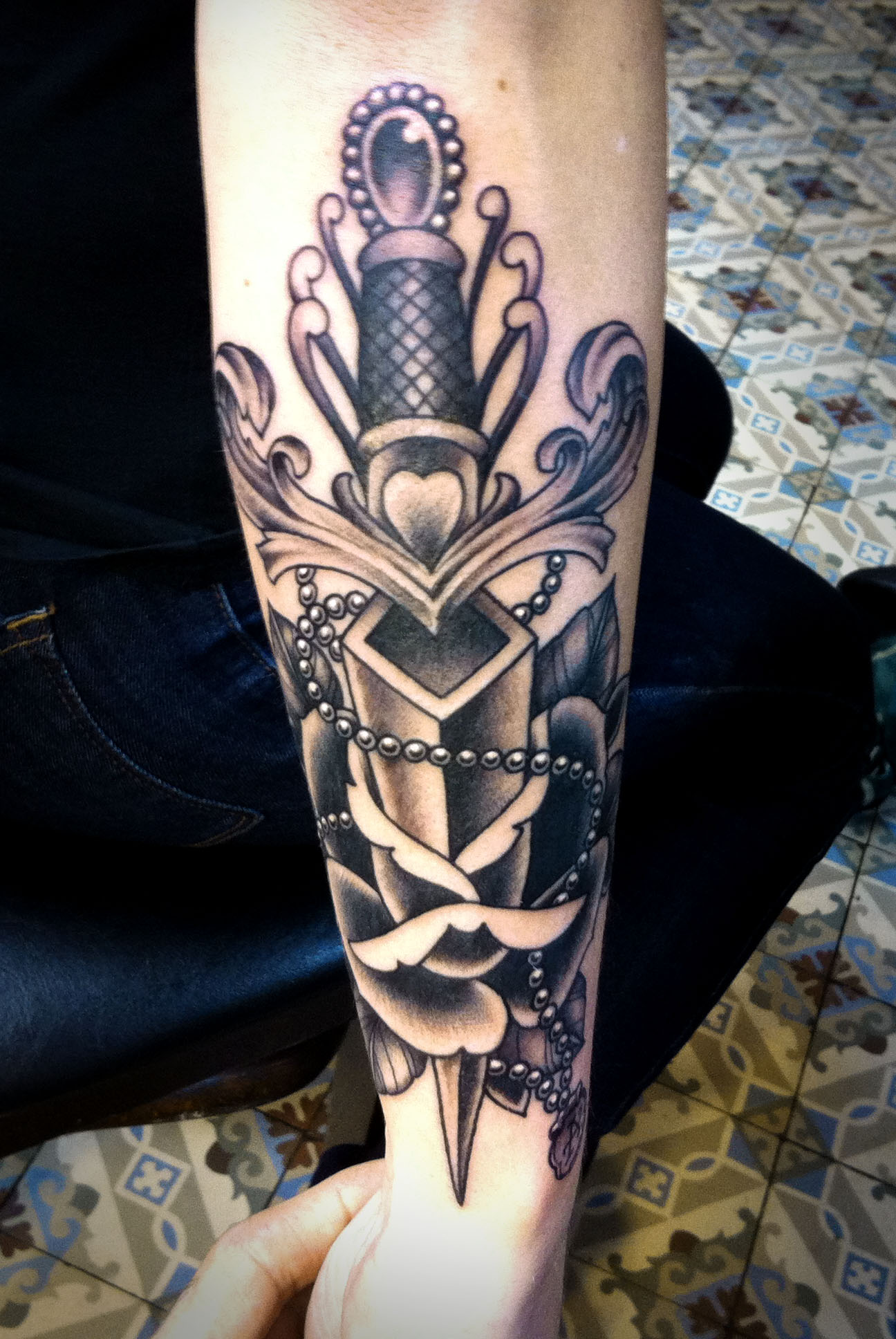 Dagger Rose Tattoo On Lower Arm
