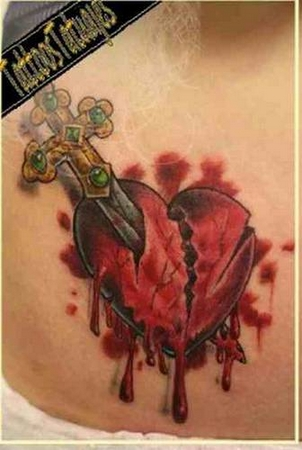 Dagger Through A Bleeding Heart Tattoo