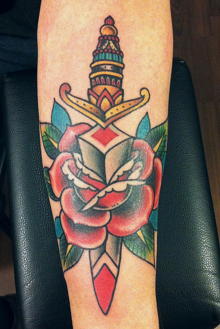 Dagger Through A Red Rose Tattoo Design