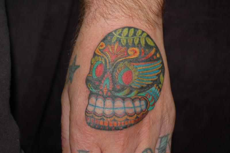Dia De Los Muertos Skull Teeth Tattoo On Hand