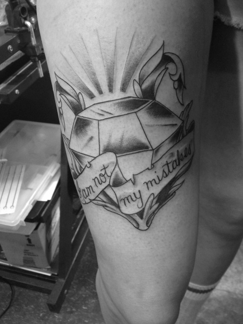 Diamond With Banner Tattoo On Thigh