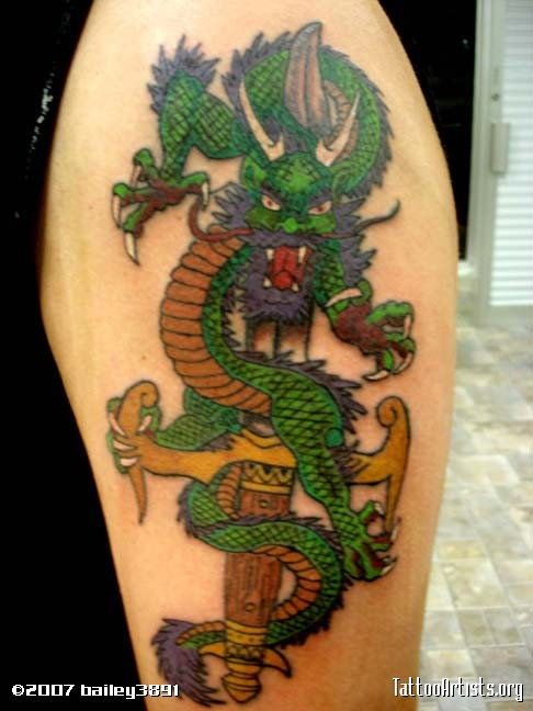 Dragon Dagger Tattoo On Upper Arm