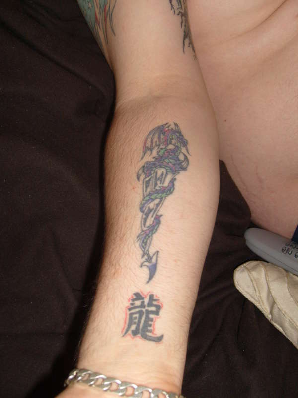 Dragon With Dagger Tattoo On Forearm
